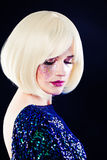 Pretty Woman with Blonde Bob Hairstyle and Glitter Makeup Royalty Free Stock Photo