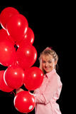 Pretty woman in blouse with red balloons Royalty Free Stock Photo
