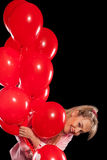 Pretty woman in blouse with red balloons Stock Images