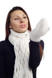 Pretty woman blow on her hands Stock Photography
