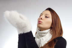 Pretty woman blow on her hands Stock Images