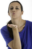 Pretty Woman Blowing A Kiss Royalty Free Stock Photography