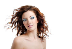 Pretty woman with blown hairs Stock Photography