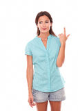 Pretty woman in blue blouse pointing up Stock Photography