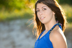 Pretty woman in blue dress Royalty Free Stock Photography