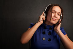 Pretty Woman in Blue Dress with Headphones Stock Images