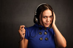 Pretty Woman in Blue Dress with Headphones Stock Photos