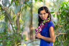 Pretty Woman in Blue Dress Holding Purple Flower Royalty Free Stock Photo