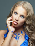 Pretty woman with blue dress Stock Images