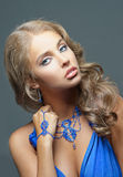 Pretty woman with blue dress Stock Image