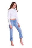 Pretty woman in blue jeans Royalty Free Stock Photography