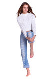 Pretty woman in blue jeans Stock Photo
