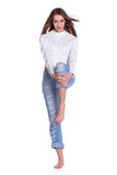 Pretty woman in blue jeans Stock Photography