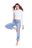 Pretty woman in blue jeans Stock Image