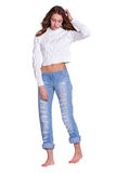 Pretty woman in blue jeanse Stock Images