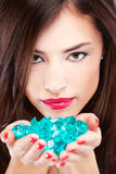 Pretty woman with blue rocks Stock Photography