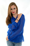 Pretty woman with blue shirt. Beautiful young woman posing with a blue shirt and jeans Stock Photography