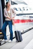 Pretty woman boarding a train Royalty Free Stock Photo