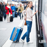 Pretty  woman boarding a train Royalty Free Stock Image