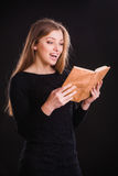 Pretty woman with book Royalty Free Stock Photography
