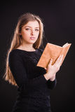 Pretty woman with book Royalty Free Stock Photo