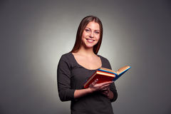 Pretty woman with books Royalty Free Stock Image