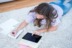 Pretty woman with books and tablet pc Stock Photos