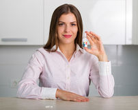 Pretty woman with a bottle of pills Stock Image