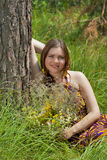 Pretty woman with bouquet of wild flowers Stock Photos