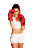 Pretty woman with boxing gloves and a fighter look Royalty Free Stock Images