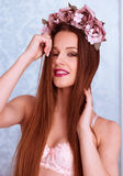 Pretty Woman in Bra with Rose Flowers on her Head Stock Photography