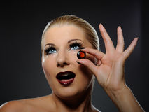 Pretty woman with bright make-up and jewel Stock Images