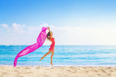 Pretty woman with bright violet fabric Stock Images