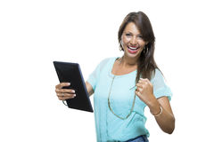 Pretty Woman Browsing at her Tablet Computer Stock Photography