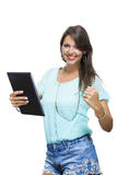 Pretty Woman Browsing at her Tablet Computer Stock Image