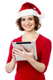Pretty woman browsing her tablet pc Stock Photo
