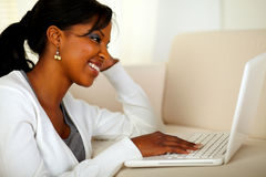 Pretty woman browsing the Internet on laptop Royalty Free Stock Photos