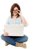 Pretty woman browsing on laptop Stock Images