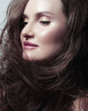 Pretty Woman Brunette with Blowing Healthy Hair Royalty Free Stock Images