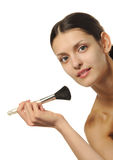 The pretty woman with a brush for a makeup Royalty Free Stock Photos