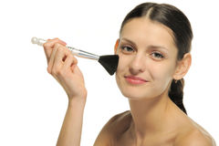 The pretty woman with a brush for a makeup Stock Photo