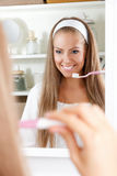 Pretty woman brushing her teeth Royalty Free Stock Photo