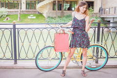Pretty woman with bugs using mobile phone near vintage bicycle Royalty Free Stock Photography