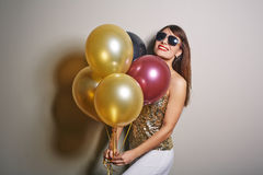 Pretty Woman with Bunch of Balloons Stock Images