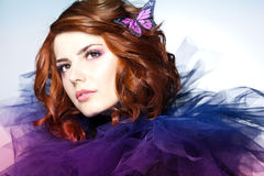 Pretty woman with a butterfly in her red hair - beauty shot royalty free stock photo