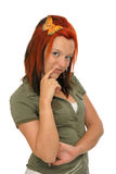 Pretty woman with a butterfly in her red hair Royalty Free Stock Photography