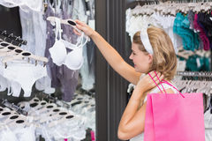 A pretty woman buying bras Stock Photo