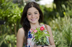 Pretty woman buying plants Stock Photography