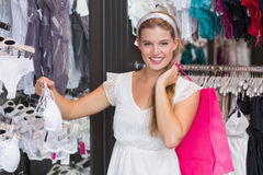 Pretty woman buying sexy lingerie Stock Photo