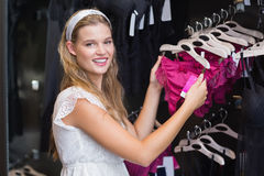 Pretty woman buying sexy lingerie Royalty Free Stock Image